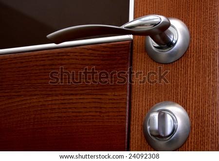 door with metal handle - stock photo