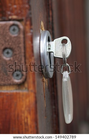 door with the key and key fob - stock photo