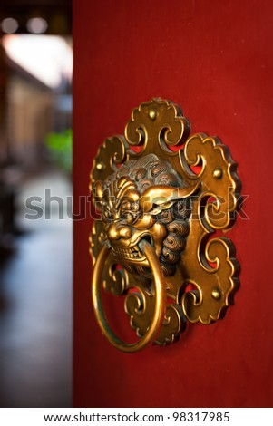 Doorknob of the Temple shaped as a jiaotu (dragon). Shuang Lin Temple, Singapore - stock photo
