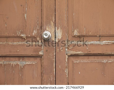 Doorknob on wood brown door - stock photo