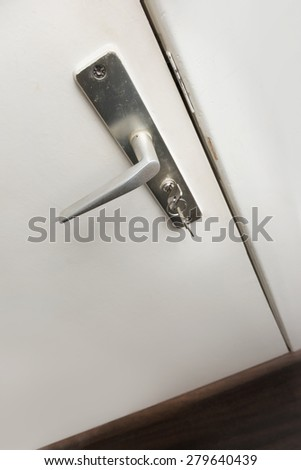 Doorknob with key - stock photo