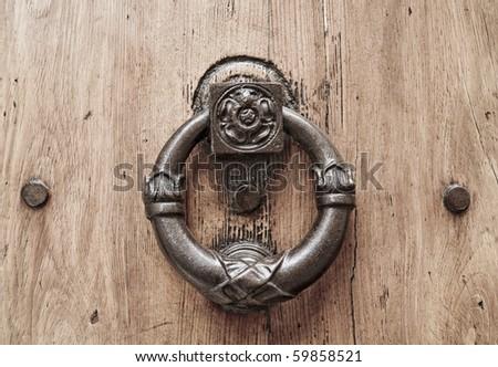 Doorknocker on allwood door. - stock photo