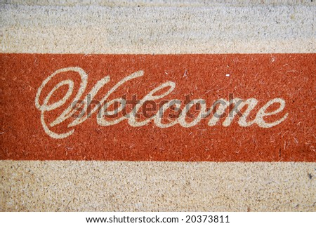 Doormat with welcome sign - stock photo