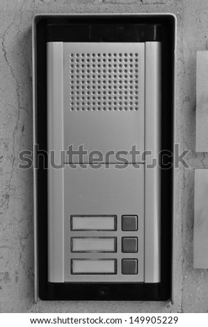 Doorphone intercom doorbell with buttons and speaker. Black and white.