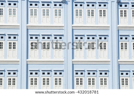 Doors and windows of the blue. Blue building that is located in Singapore's Chinatown. - stock photo