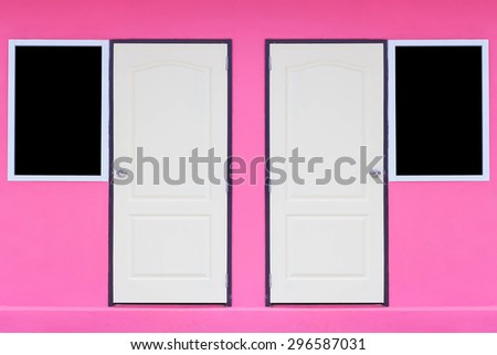doors and windows on pink wall - stock photo