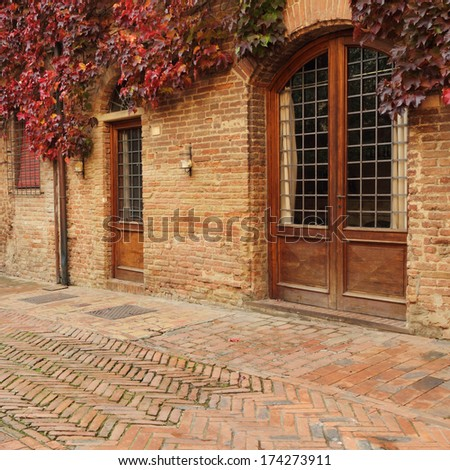 doors in small old tuscan town  in autumnal colors, Certaldo, Italy - stock photo