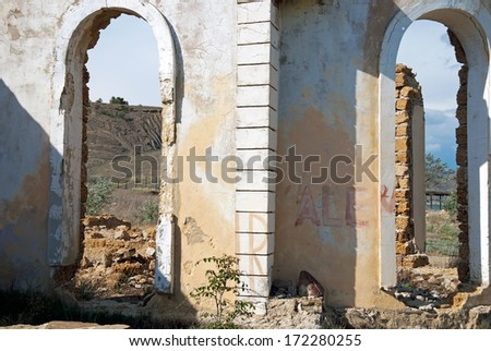 doors in the ruins of the wall - stock photo