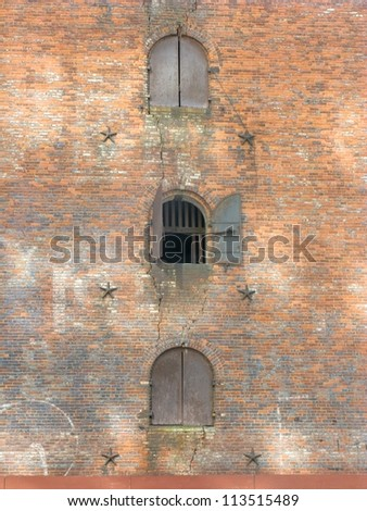 Doors in the side of an old Brooklyn warehouse, Brooklyn, NYC - stock photo