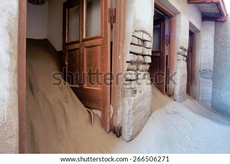 Doors of abandoned house in sand. Shot in Kolmanskop ghost town, Namibia. - stock photo