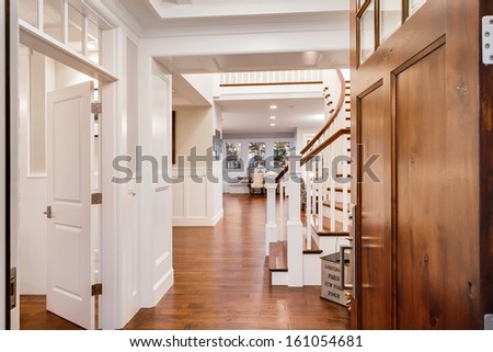 Doorway and Entryway to Large and Luxurious New Home - stock photo