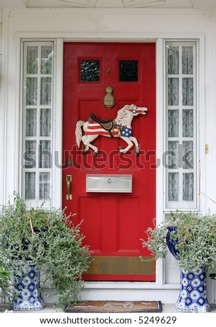 doorway decorated with horse and plants