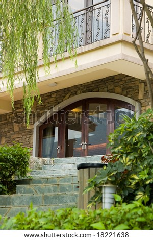 Doorway in front of a villa - stock photo