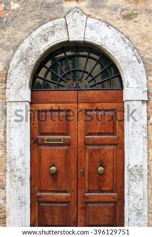 Doorway in Pienza, Tuscany, Italy - stock photo