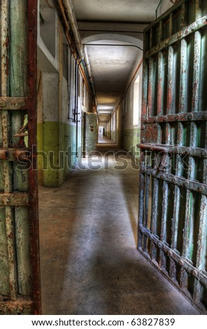 Doorway into an abandoned prison - stock photo