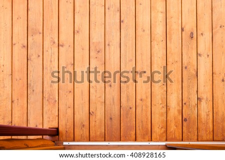 Doorway leading onto wooden deck or porch from straight above with rich warm wood colors and grain textures - stock photo