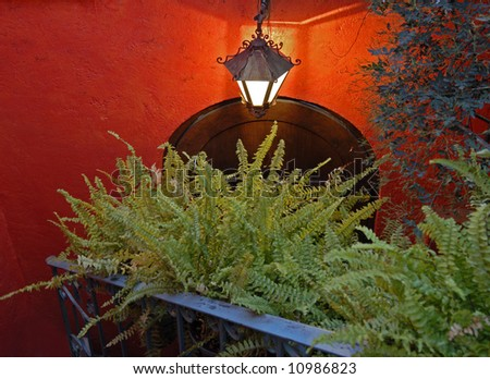 Doorway leading to the street from interior courtyard in San Miguel de Allende, Mexico - stock photo