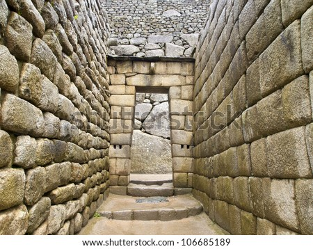 Doorway of the Inca temple at the lost city of Machu Picchu, Peru - stock photo
