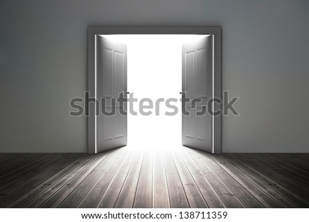 Doorway revealing bright light in dull grey room - stock photo