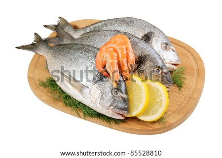 Dorado fish and shrimp on cutting board isolated