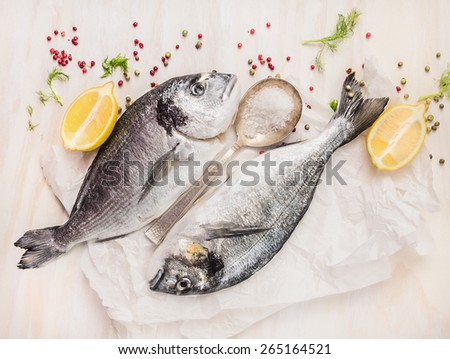 Dorado fish composing with lemon, spices and salt, top view - stock photo