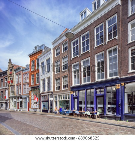 DORDRECHT-MEI 28, 2017. Picturesque street with former stately mansions in the ancient city center of Dordrecht which houses the medieval port area with almost 1000 monuments and many ancient canals.