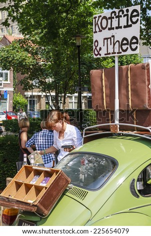 DORDRECHT, NETHERLANDS - AUGUSTUS 10, 2014: Pouring coffee, serving drinks out of a car at the summer Swan Market in Dordrecht. The lifestyle market was originally started in vacant shops in Rotterdam - stock photo