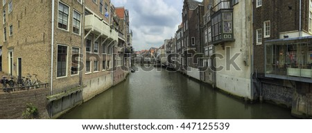 DORDRECHT, NETHERLANDS-JUNE 28,2016: Panoramic view on the canal and historical houses in Dordrecht, Holland. Dordrecht is the eldest city in Holland   - stock photo
