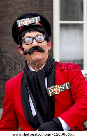DORDRECHT, THE NETHERLANDS - NOVEMBER 18: Man dressed as the postman of Santa Claus participating in a parade celebrating the arrival of Santa Claus on November 18, 2012 in Dordrecht, Netherlands. - stock photo