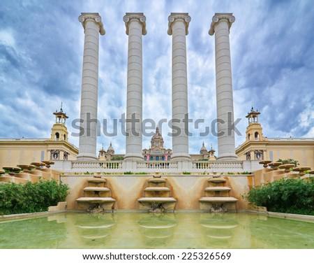 Doric columns and reflecting pool in front of the National Palace (Palau Nacional) hosting the National Art Museum of Catalonia (Museu Nacional d'Art de Catalunya) in Montjuic, Barcelona, Spain - stock photo