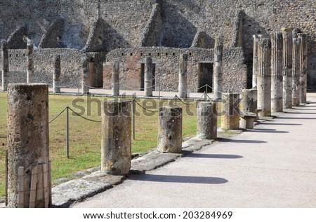 Doric columns in the gladiator barracks, Pompeii - stock photo