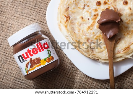 DORKOVO, BULGARIA - DECEMBER 12, 2017: Pancakes with Nutella. Introduced to the market in 1964 by Italian company Ferrero, Nutella is widely popular brand name of a chocolate cream