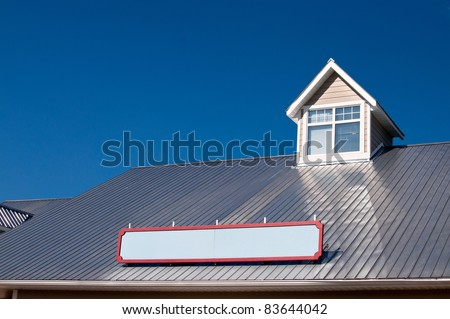 Dormer window on metal roof - stock photo