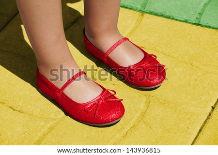 Dorothy ruby slippers on yellow brick road: Wizard of Oz concept - stock photo
