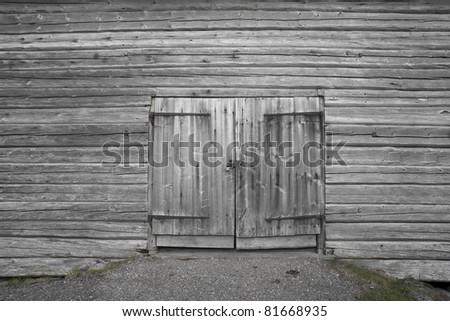 Dorr on old gray wooden barn - stock photo