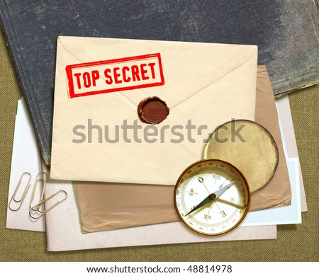 dorsal view of military top secret documents with stamp - stock photo