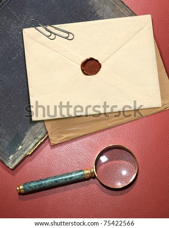 dorsal view of military top secret envelope with magnifier - stock photo