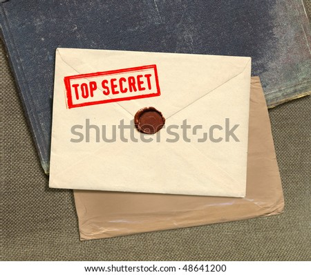 dorsal view of military top secret envelope with stamp - stock photo