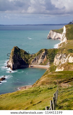 Dorset coastline looking towards Durdle Door, the route of the South-West coastal path. - stock photo