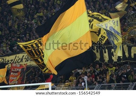 DORTMUND, GERMANY - OCT 1: BVB Fans celebrating during a Champions League match between Borussia Dortmund & Olympique de Marseille, final score 3-0, on October 1, 2013, in Dortmund, Germany. - stock photo