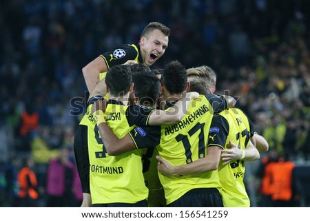 DORTMUND, GERMANY - OCT 1: Grosskreutz, Lewandowski, Aubameyang & Durm (BVB) celebrating during a match between Borussia Dortmund & Olympique de Marseille on October 1, 2013, in Dortmund, Germany. - stock photo