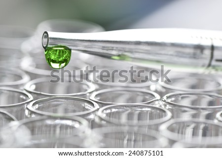 Dosage drop tube in the laboratory  - stock photo