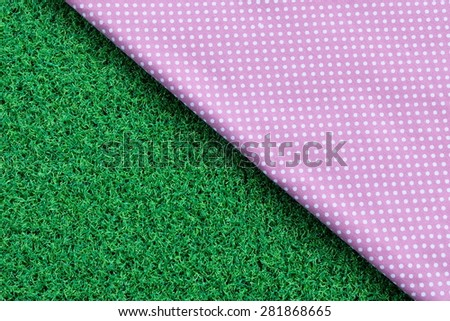 dot cloth on green grass background