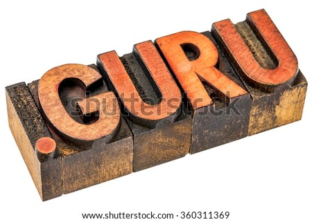 dot guru top level internet domain, isolated text in grunge letterpress wood type - stock photo