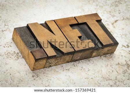 dot net- network internet domain in vintage letterpress wood type on ceramic tile background - stock photo