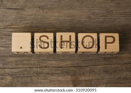 dot shop - internet domain for e-commerce - stock photo
