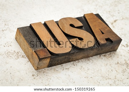 dot USA - internet concept - fictitious  domain address (not .us) - letterpress wood type on ceramic tile background - stock photo