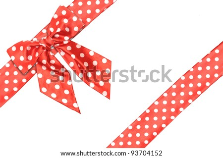 dotted red satin gift bow and ribbon isolated on white - stock photo