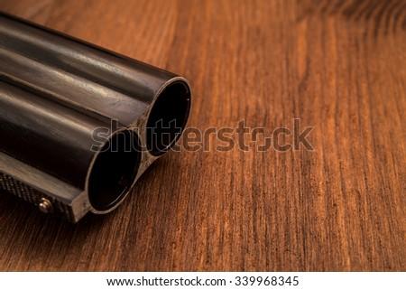 Double-barreled shotgun barrel close-up - stock photo