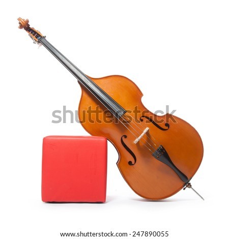 double bass leans against red box in studio with white background